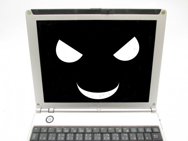 黒い顔のパソコンの画面
